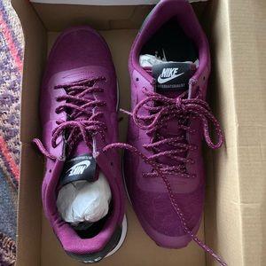 Nike Internationalist athletic shoes